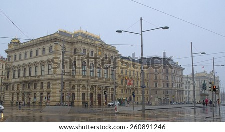WIEN, AUSTRIA, JANUARY 4, 2015: view of the snow storm hitting schwarzenberg street in wien, where magnificent buildings stretch alongside the boulevard. - stock photo
