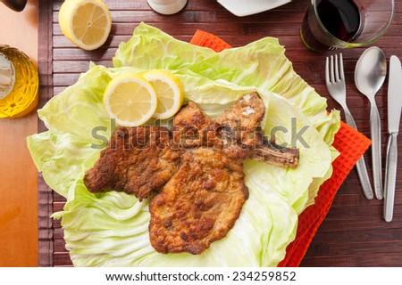 Wiener Schnitzel with lettuce - stock photo