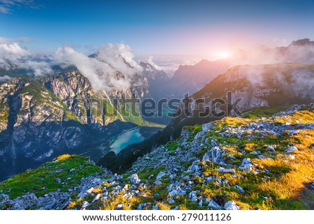 Wiev of canyon Landro (Durrensee) lake, in the morning mist. National Park Tre Cime di Lavaredo. Dolomites, South Tyrol. Location Auronzo, Italy, Europe. - stock photo