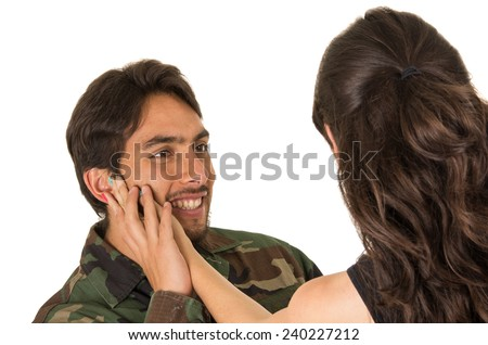 wife caressing her returning young military soldier husband isolated on white - stock photo