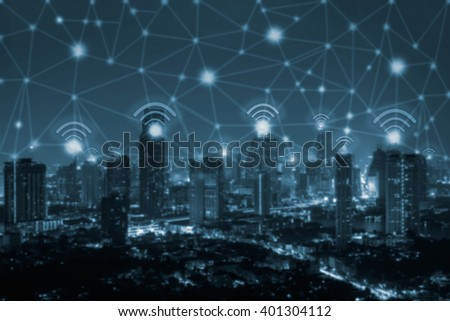 wifi icon and blue tone city scape and network connection concept - stock photo