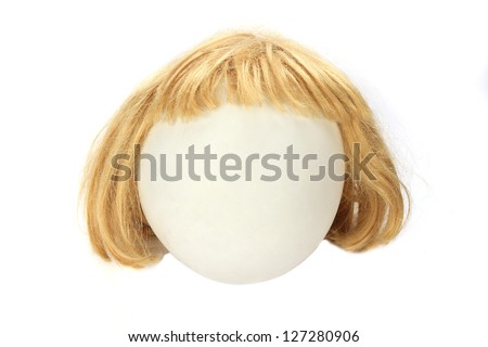 Wig on a balloon (cut out) - stock photo