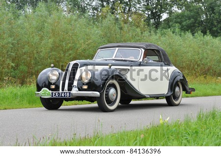 WIJHE, THE NETHERLANDS - SEPTEMBER 4: A BMW/ EMW 327 from 1954 drives past at the 10th Diekdaegen classic car tour on September 4, 2011 in Wijhe, The Netherlands - stock photo