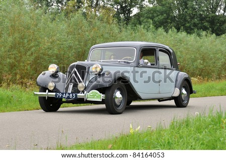 WIJHE, THE NETHERLANDS - SEPTEMBER 4: A Citroën Avant Traction 11B from 1956 drives past at the 10th Diekdaegen classic car tour on September 4, 2011 in Wijhe, The Netherlands - stock photo