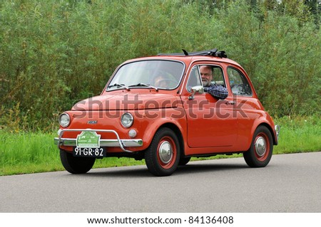 WIJHE, THE NETHERLANDS - SEPTEMBER 4: A Fiat 500 from 1975 drives past at the 10th Diekdaegen classic car tour on September 4, 2011 in Wijhe, The Netherlands - stock photo