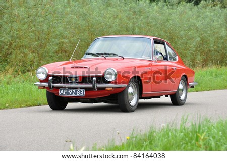 WIJHE, THE NETHERLANDS - SEPTEMBER 4: A Glas 1700GT from 1967 drives past at the 10th Diekdaegen classic car tour on September 4, 2011 in Wijhe, The Netherlands
