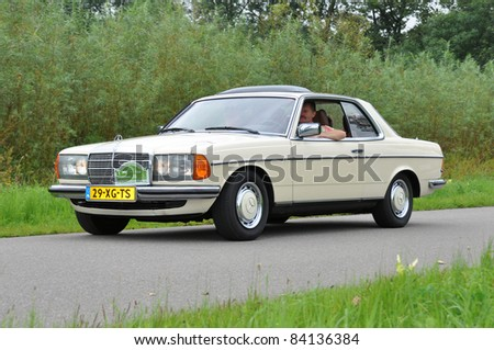 WIJHE, THE NETHERLANDS - SEPTEMBER 4: A Mercedes-Benz 230C from 1979 drives past at the 10th Diekdaegen classic car tour on September 4, 2011 in Wijhe, The Netherlands - stock photo