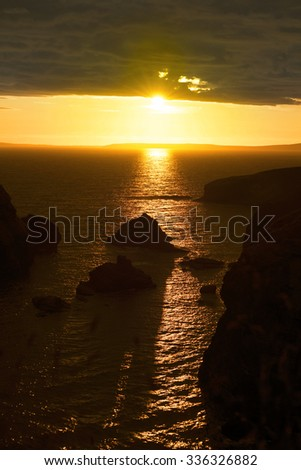wild atlantic way sunset on the coastline of ballybunion county kerry ireland with wild grass in foreground - stock photo