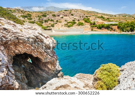 Wild beach with rocks and turquoise water. Agios Pavlos, Crete island, Greece. Beautiful summer landscape with sea view - stock photo