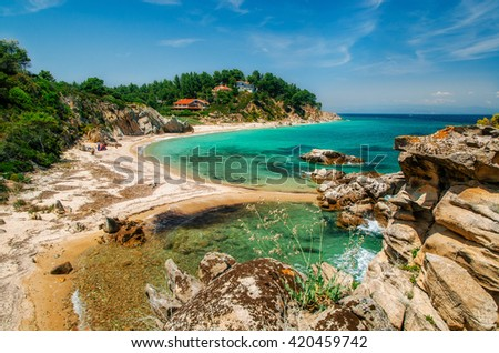 Wild beautiful beach with turquoise water in Vourvourou, Sithonia, Greece - stock photo