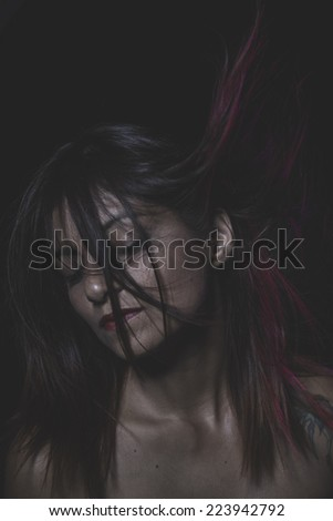 Wild, Beautiful latina woman with hair flying - stock photo