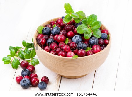 Wild berry in wooden cup  - stock photo