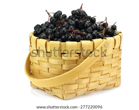 Wild black chokeberry (aronia) in basket on a white background   - stock photo