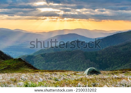 Wild camping on the ridge of Bieszczady national park while having an amazing view on sunset - stock photo