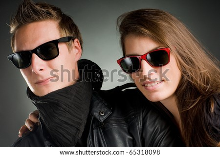 wild couple with sunglasses and leather jacket - stock photo