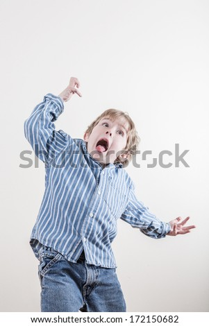 Wild funny little boy - stock photo
