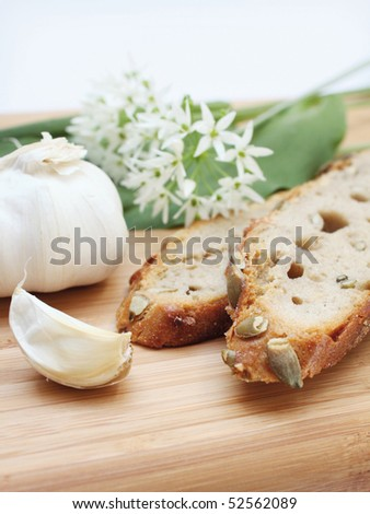 wild garlic, garlic and bread - stock photo