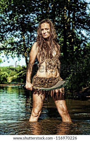 Wild girl posing with a loincloth on the nature - stock photo