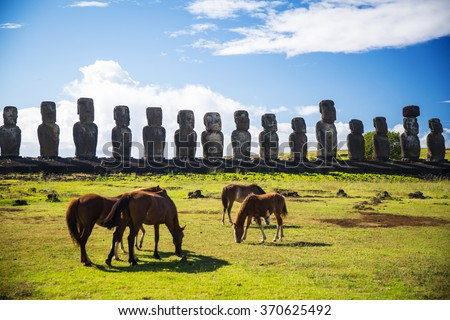 Wild horses against Ahu Tongariki. Easter Island - stock photo