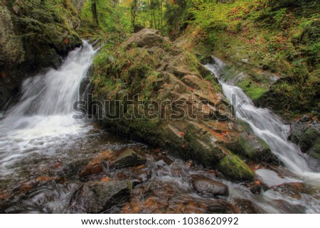 wild landscape with waterfalls in forest