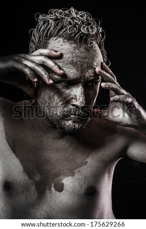 wild man, tribal concept, traditions, body covered with mud
