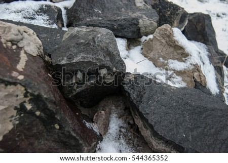 wild, raw granite stones, with snow in winter
