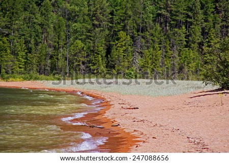 wild shores of Lake Baikal in Russian Siberia - sandy beach and forest in background,  stylized and filtered to resemble an oil painting - stock photo