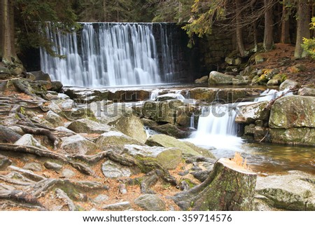 Wild waterfall in the Polish mountains. River with cascades - stock photo