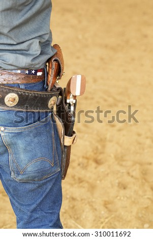 wild west cowboy with gun and leather holster