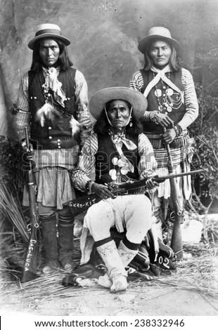 Wild West. Das-Luca, Skro-Kit, Shus-El-Day: White Mountain Apaches posed with rifles, 1909. - stock photo