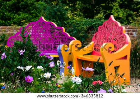 Wildflower garden and benches outdoor relaxing space  - stock photo