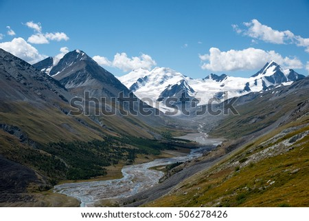 Wildlife Altai. The river, mountains and blue sky with clouds in summer