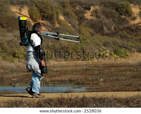 Wildlife Photographer Looking For His Next Subject - stock photo