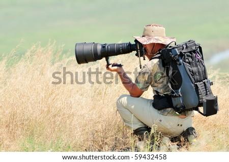wildlife photographer outdoor - stock photo