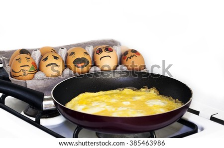 will we be the next? Eggs in a egg box are scared of dead friends - stock photo