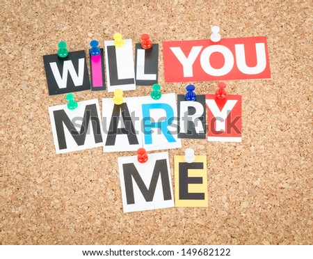 Will You Marry Me, pinned on cork bulletin board. - stock photo