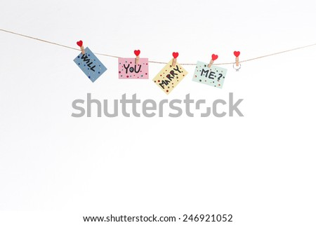 Will you marry me question hanged on rope - stock photo