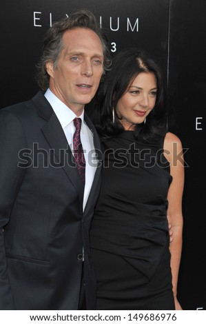 "William Fichtner & Kymberly Kalil at the world premiere of his movie ""Elysium"" at the Regency Village Theatre, Westwood. August 7, 2013  Los Angeles, CA"