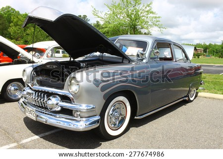 WILLIAMSBURG, VA - May 9, 2015: A customized 1951 Ford Custom at the 6th Annual Project Lifesaver Car Show in Williamsburg Virginia on a summer day. - stock photo