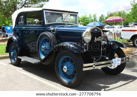 WILLIAMSBURG, VA - May 9, 2015: An old 1931 Ford A400 at the 6th Annual Project Lifesaver Car Show in Williamsburg Virginia on a summer day. - stock photo