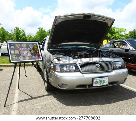 WILLIAMSBURG, VA - May 9, 2015: An old 1980's Mercury Police car at the 6th Annual Project Lifesaver Car Show in Williamsburg Virginia on a summer day. - stock photo