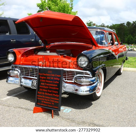WILLIAMSBURG, VA - May 9, 2015: An old two tone 1956 Ford Fairlane at the 6th Annual Project Lifesaver Car Show in Williamsburg Virginia on a summer day. - stock photo