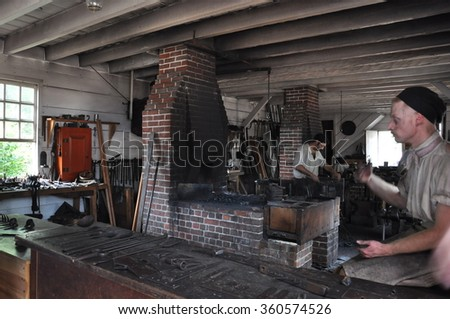 WILLIAMSBURG, VA - SEP 8: Blacksmith in Colonial Williamsburg in Virginia, as seen on Sep 8, 2015. The site re-creates the industrial complex owned and operated by James Anderson. - stock photo