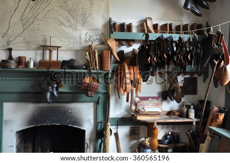 WILLIAMSBURG, VA - SEP 10: Shoemaker in Colonial Williamsburg, Virginia, as seen on Sep 10, 2015. The shoemaker's shop in Williamsburg represents the firm of George Wilson from the late 1760s. - stock photo