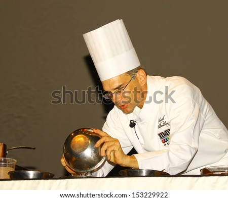 WILLIAMSBURG, VA- SEPTEMBER 5: Colonial Williamsburg chef Rhys Lewis preparing Chocolate at the 1st History meets Horsepower show in Williamsburg, Virginia on September 5, 2013 - stock photo