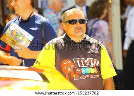 WILLIAMSBURG, VA- SEPTEMBER 5: Kyle Buschs #18 NASCAR crew member beside the race car at the 1st History meets Horsepower show in Williamsburg, Virginia on September 5, 2013 - stock photo