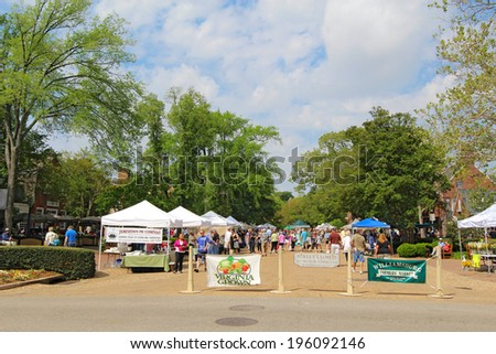 WILLIAMSBURG, VIRGINIA - APRIL 21 2012: Entrance to the Williamsburg Farmers Market in spring. The restored town is a major attraction for tourists and meetings of world leaders. - stock photo