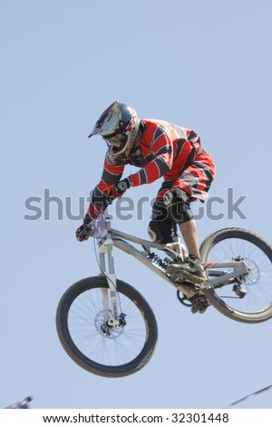 WILLINGEN, GERMANY, JUNE 13:  Mountain biker Steven Rollnik (GER) #88, racing at downhill competition, Amateur class, ending up third and qualifying for pro-class race Willingen, Germany, June 13, 2009. - stock photo
