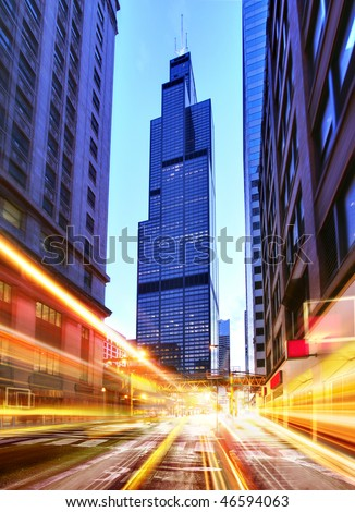 Willis Tower and modern city at night with freeway traffic - stock photo