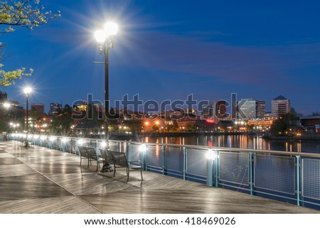 Wilmington Delaware skyline along the Riverfront at night along the Christiana River - stock photo
